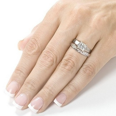 A wedding ring is worn on what hand